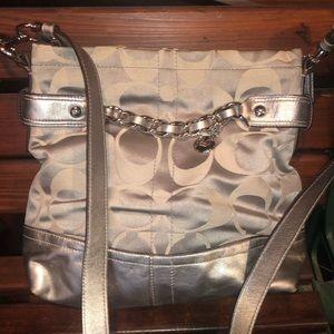 Silver cross body Coach bag